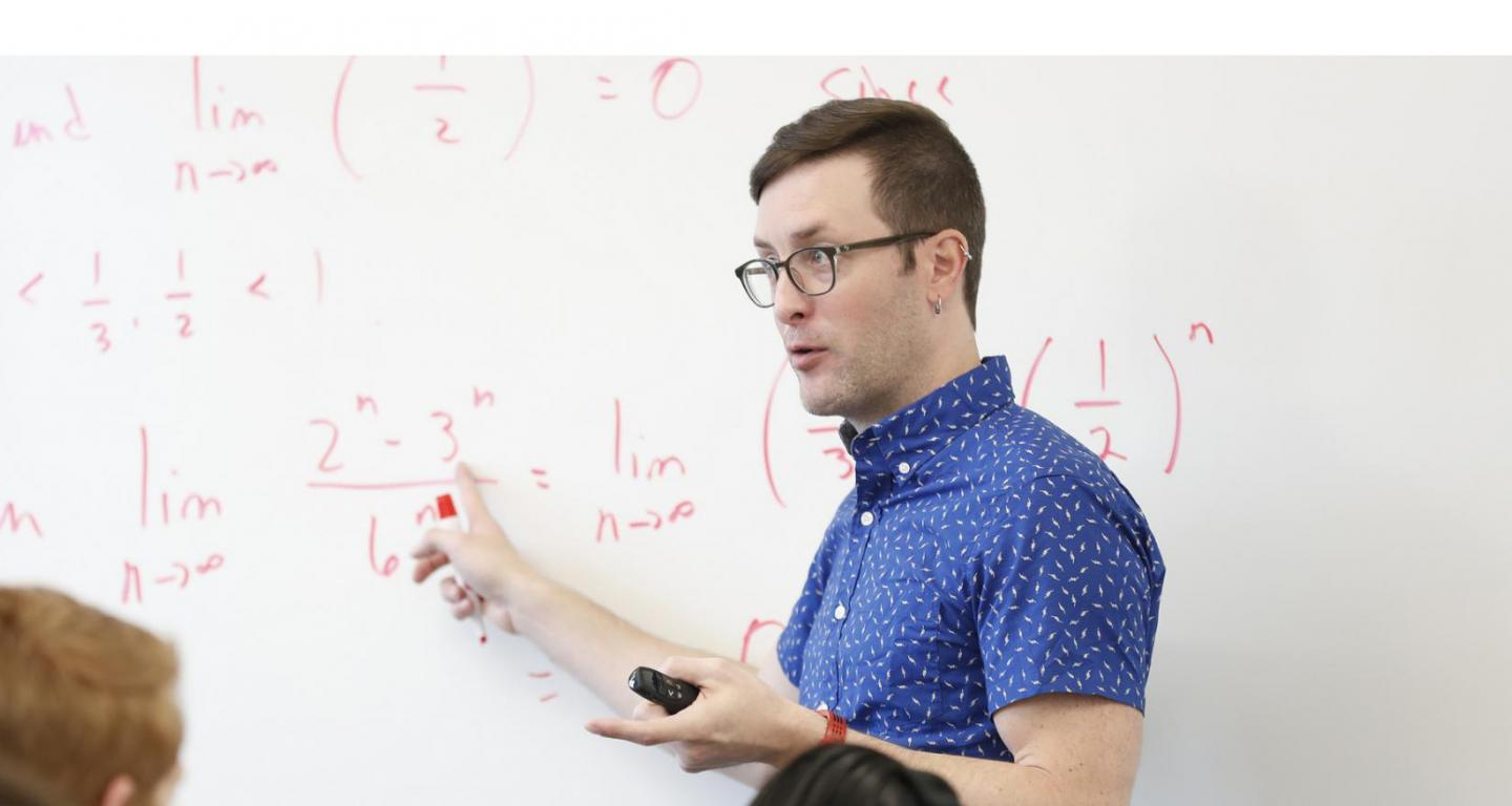 An actuarial science professor teaching a class.