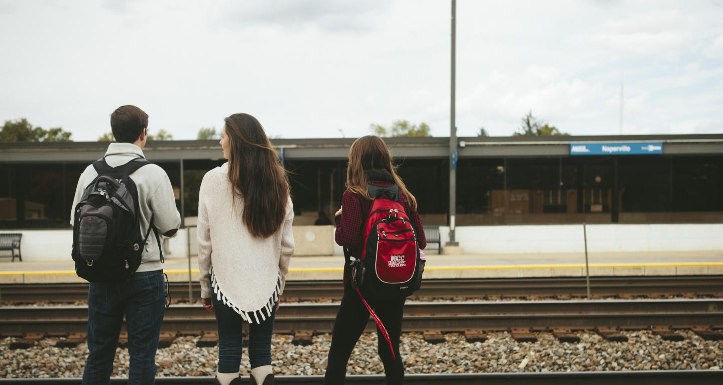 students at train station