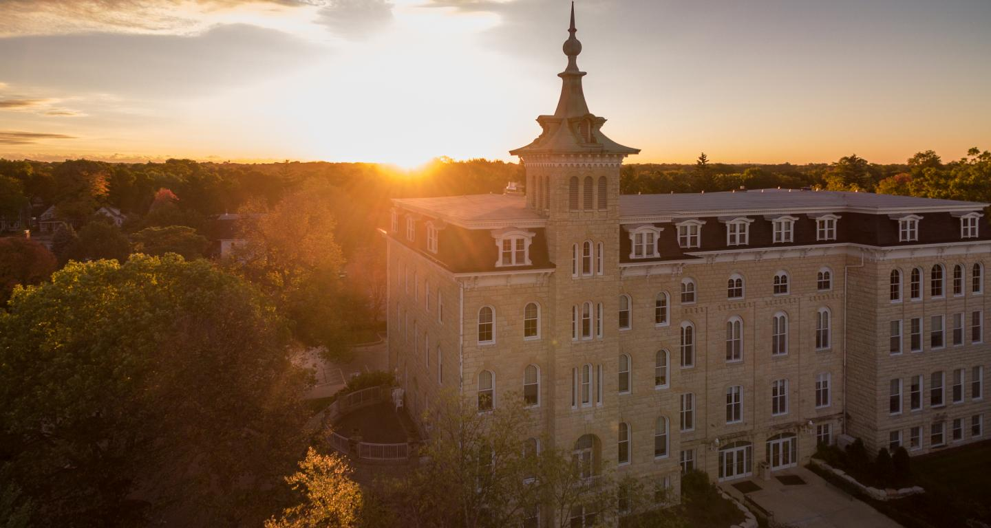 Sunset over North Central College's Old Main with Downtown Naperville in background