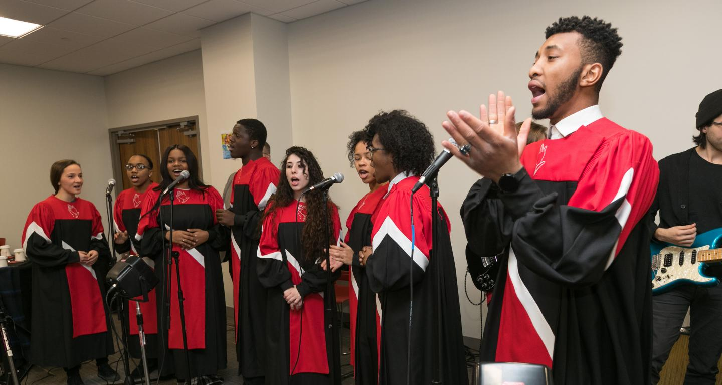 Mikel Mays leads North Central College's student gospel choir Voices of Praise.