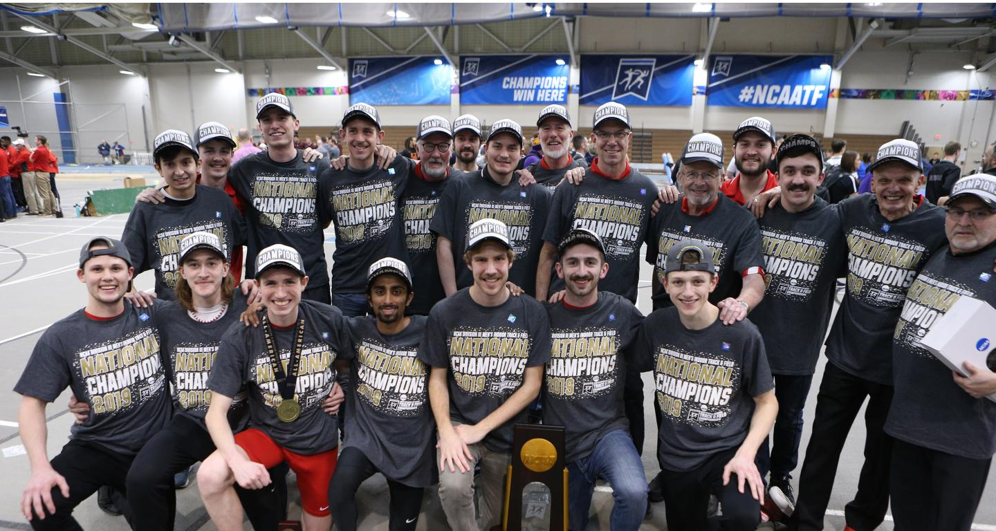 Members of the North Central College men's track and field team pose with their national indoor championship trophy.