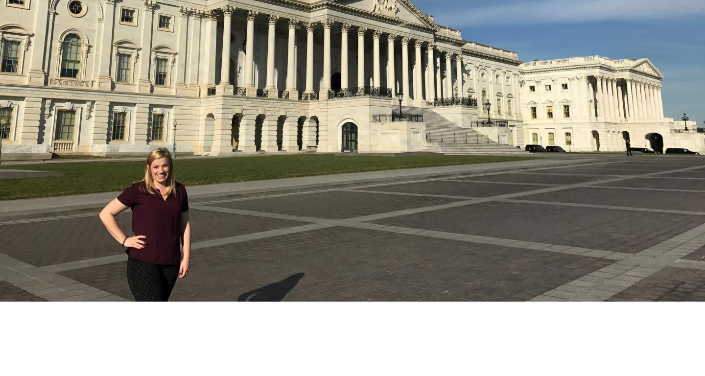 North Central College alumna Ashley Clayton standing in front of the U.S. Capitol.