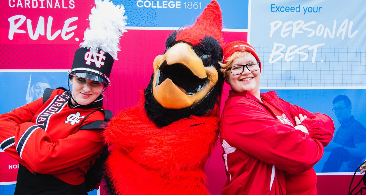 homecoming 2019 chippy the mascot poses with students in front of new branding