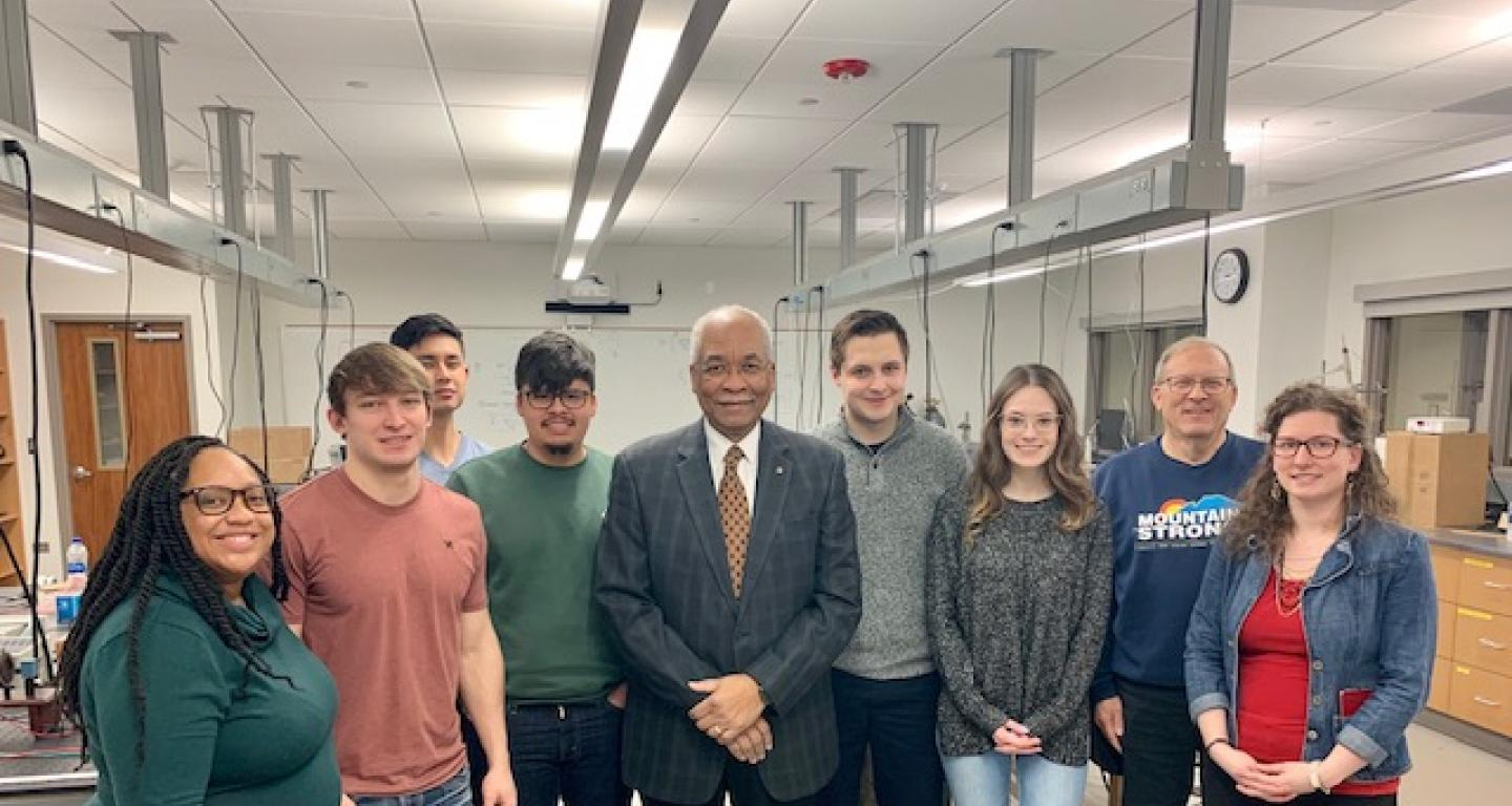 Dr. Herman B. White  with students