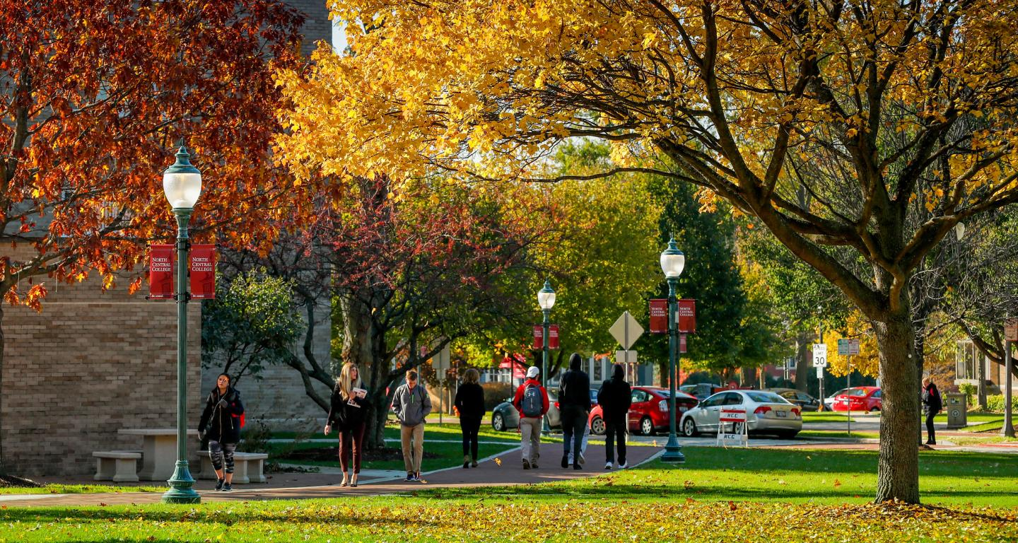 Students walking outside of Seager hall during the fall