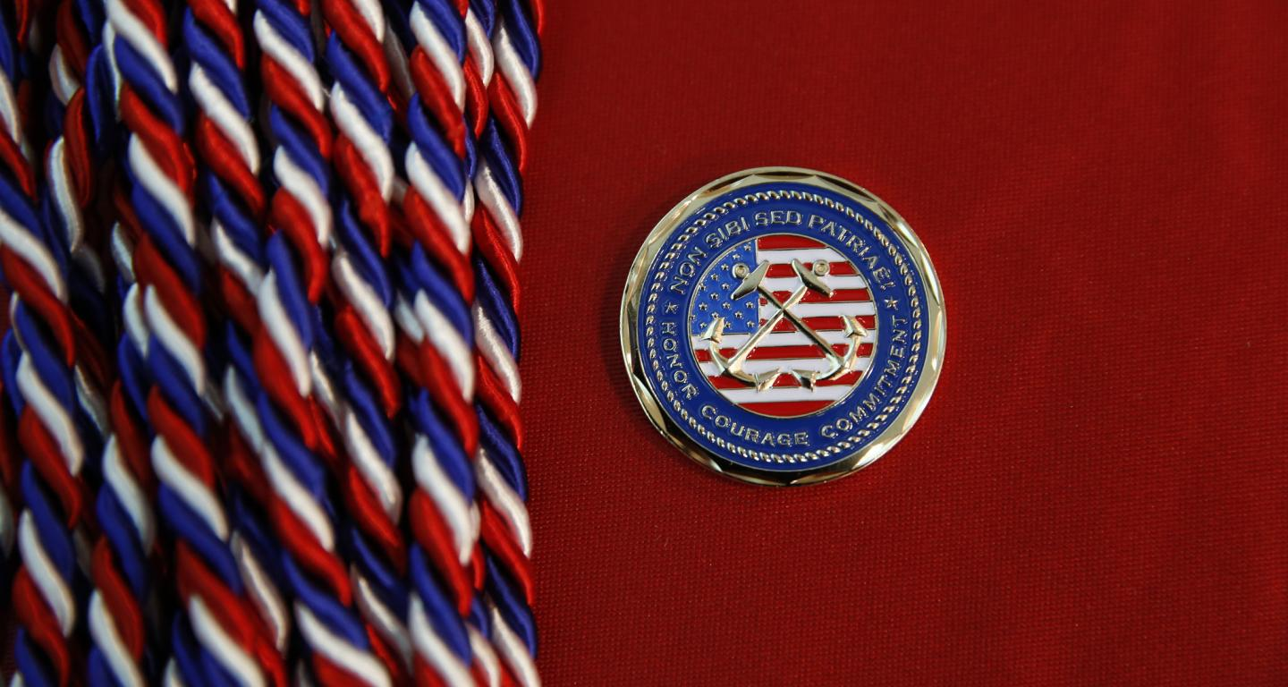 Cords and the seal given to military graduates.
