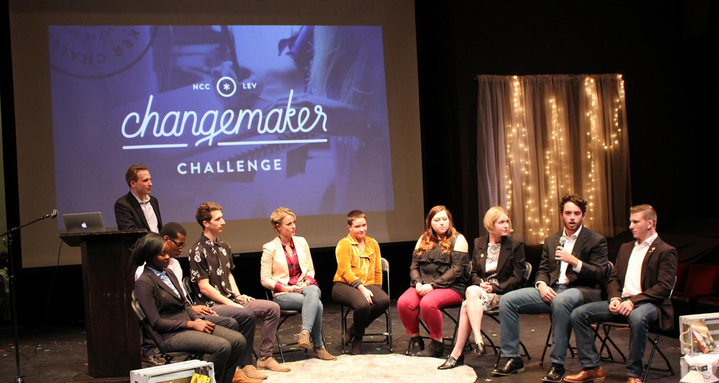 Students in discussion at the Changemaker Challenge.