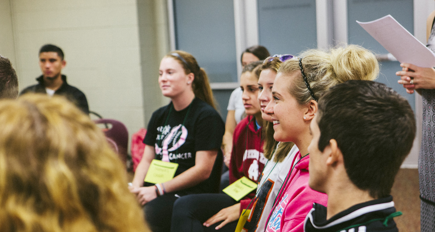 A group of North Central College students participating in a mental health seminar.