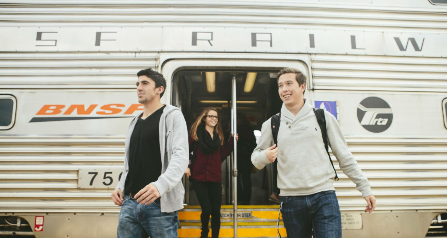 students exiting train in Naperville