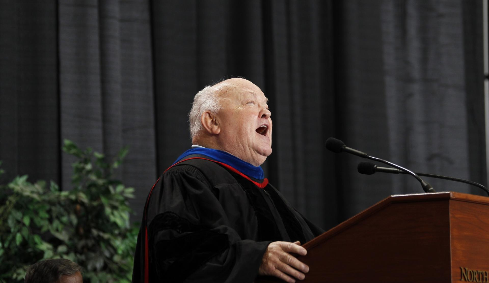 Naperville's longest-serving mayor, A. George Pradel, offers a welcome to students and their families at Commencement in 2012.