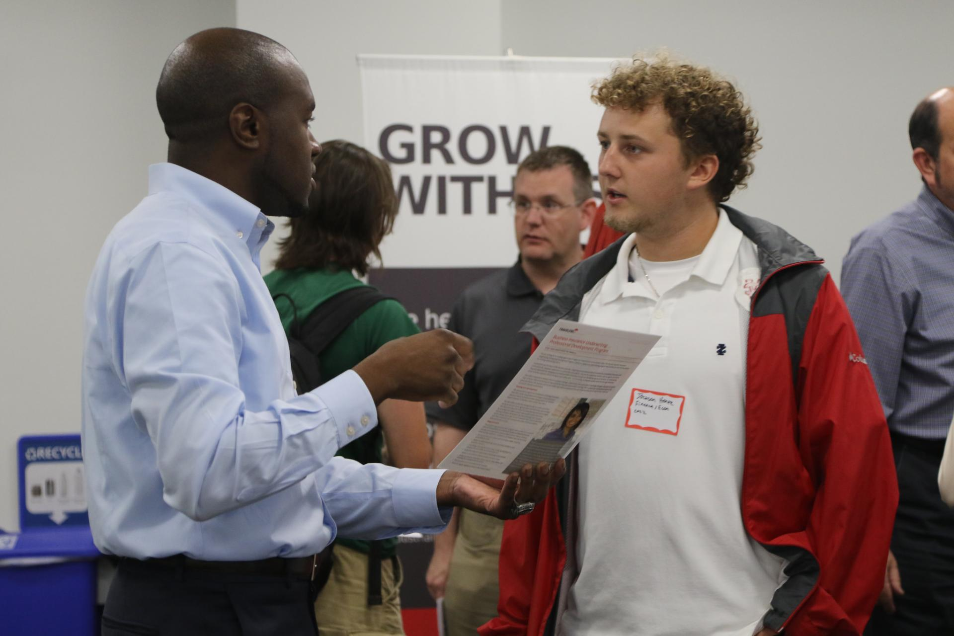 A student meets with a potential employer at the employer meet and greet held at North Central College.