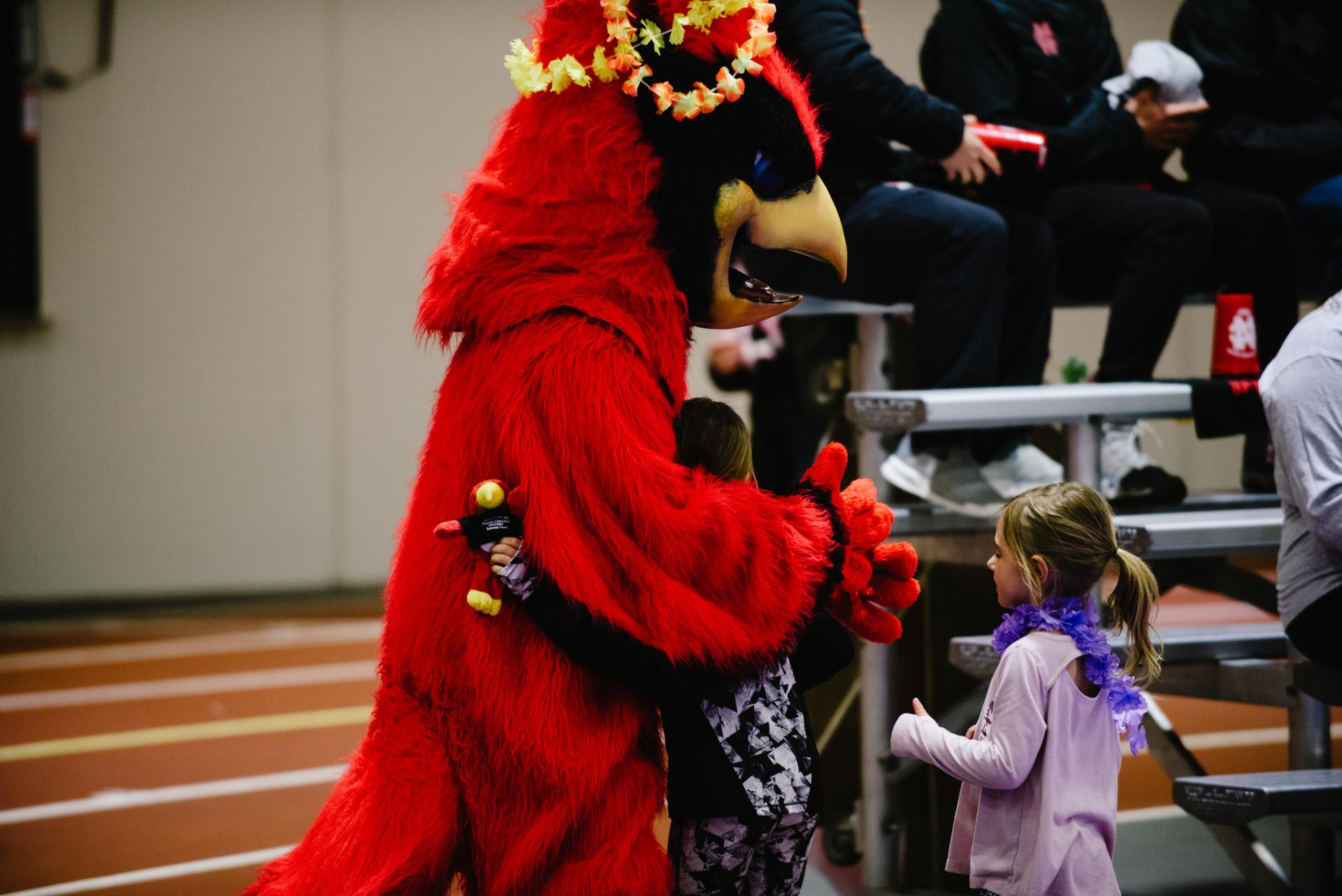 North Central mascot Chippy greets some young volleyball fans.