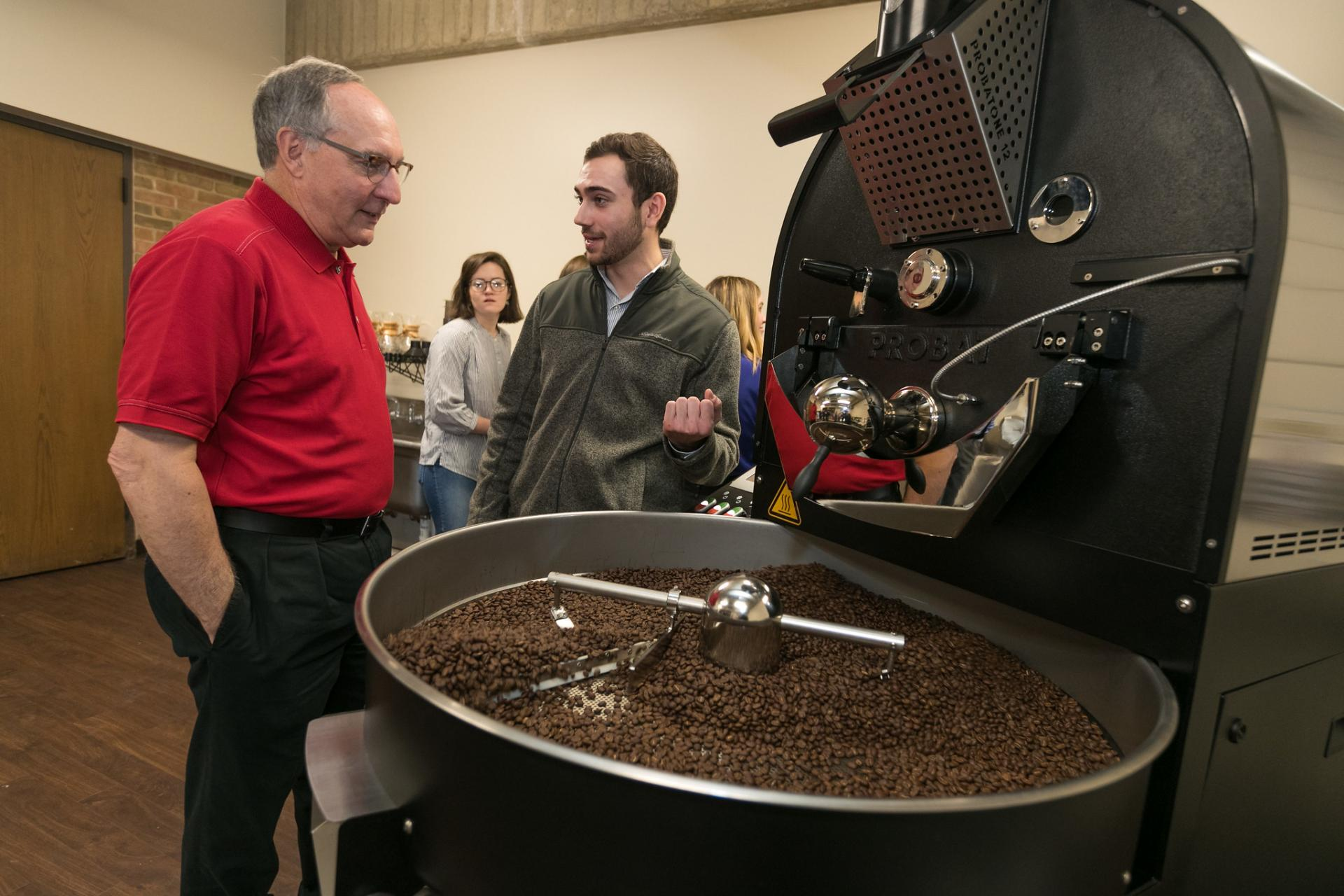 The coffee lab is toured by its founder, Jim McDermet.