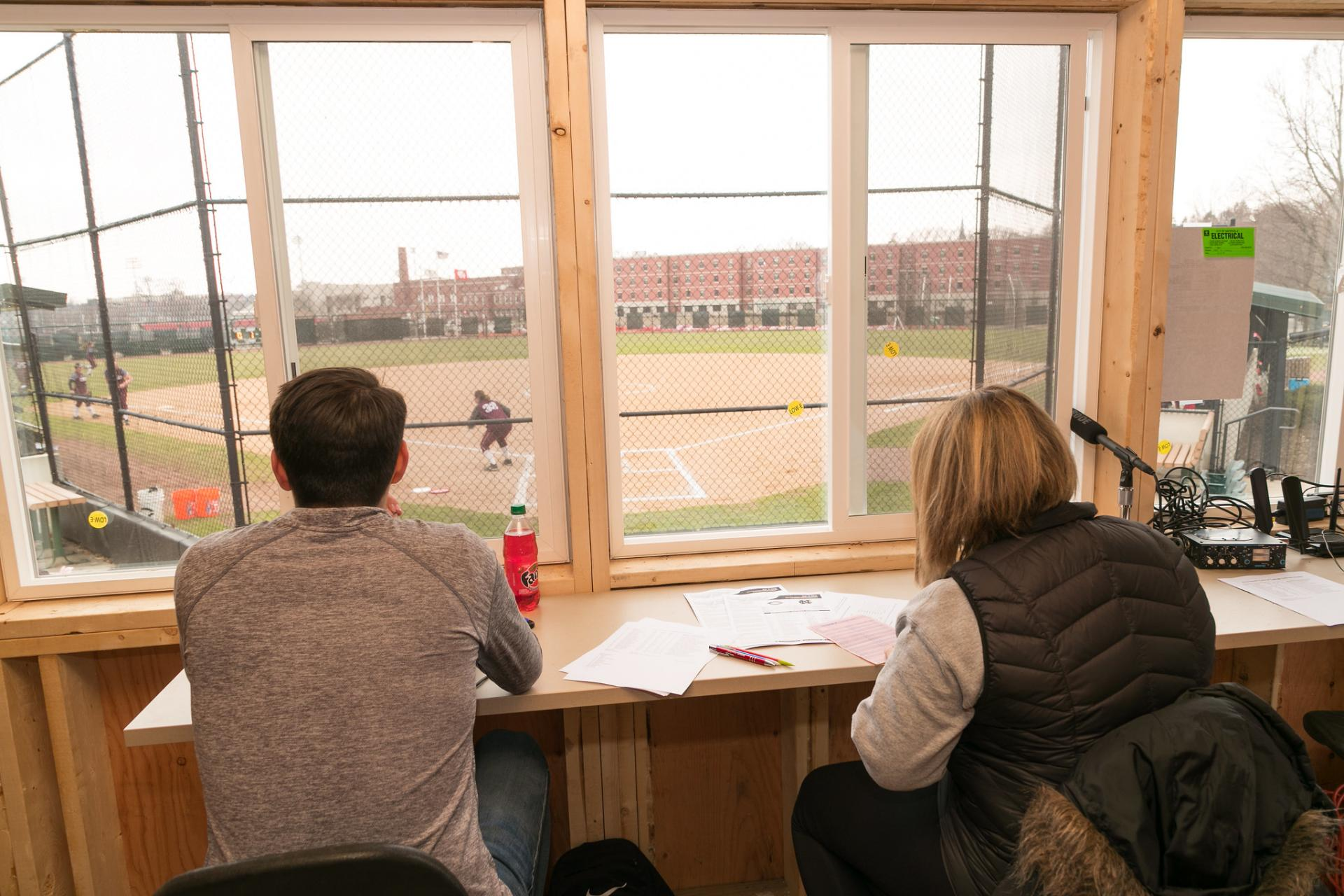 North Central students working inside the newly-donated press box at Shanower Family Field.