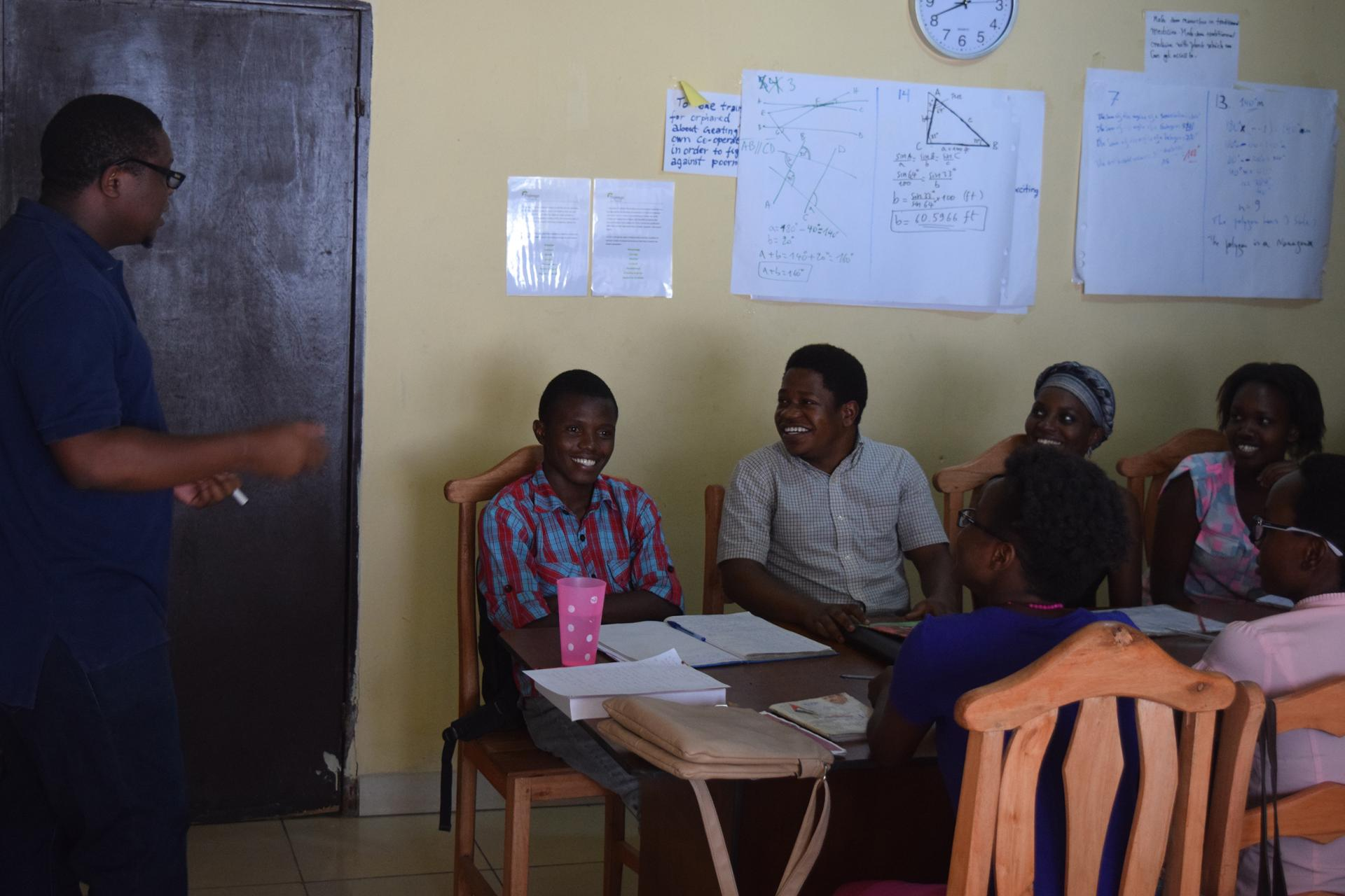 Gates Cambridge Scholar Etienne Mashuli teaching his students in the Tujenge Scholars Programme.