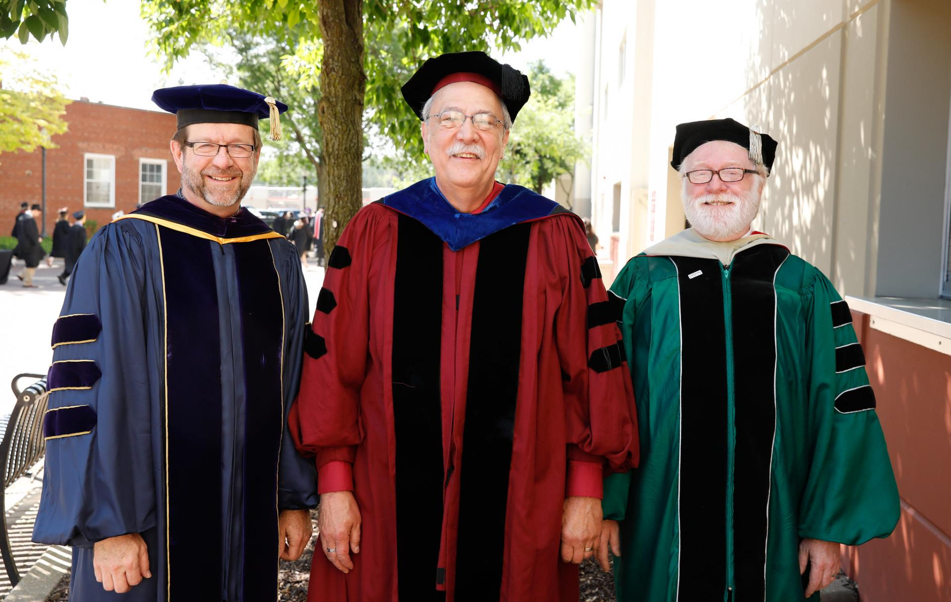 North Central College emeritus professors David Horner, James Donovan and Richard Paine.