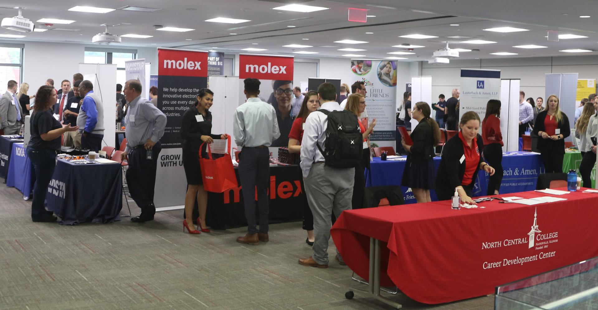 Students line up to meet companies at an event, looking for post-college careers.