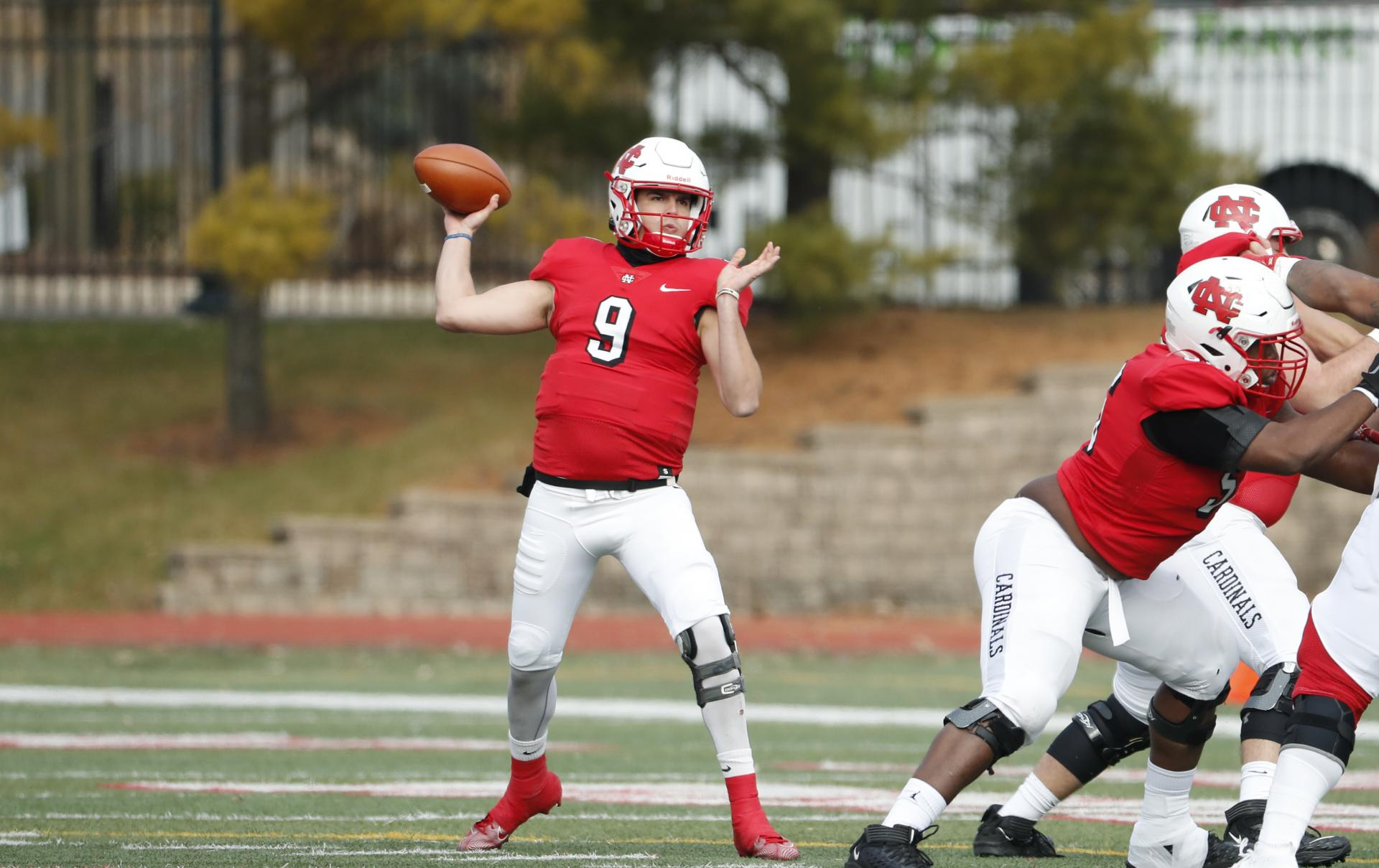 North Central College quarterback Broc Rutter throwing a pass.