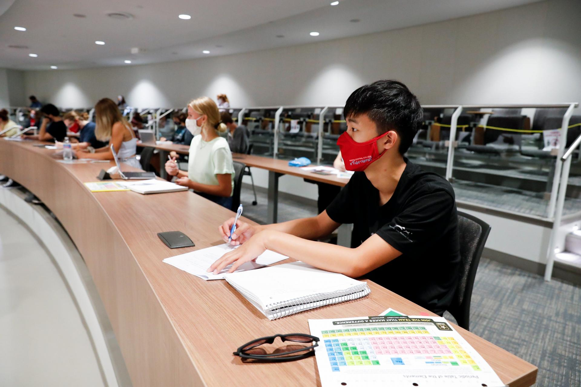 Lecture hall of North Central College students wearing facial masks due to COVID-19