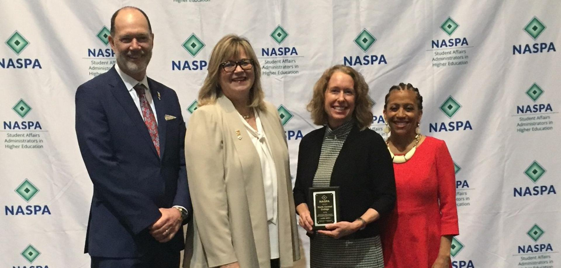 Pictured from left to right: NASPA President Kevin Kruger, NASPA Board Chair Dr. Deb Moriarty, Cardinal First Director Julie Carballo and Past NASPA Board Chair Dr. Lori White.