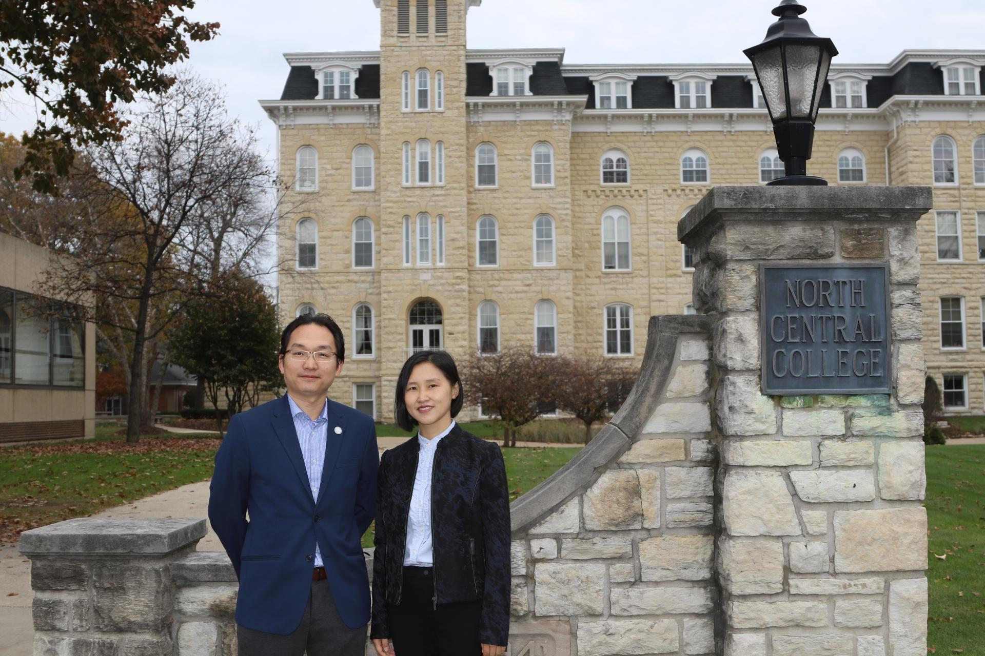 Jason Chen and Lily Chen standing in front of Old Main.