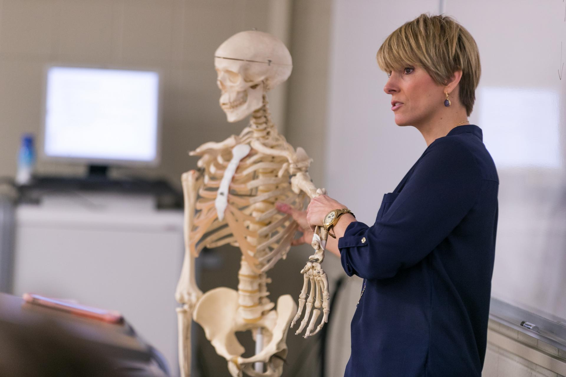 Professor Kendall Selsky teaching using a skeleton.