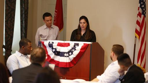 Veteran students speaking at an information session.