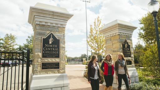 Students walking onto campus passed North Central College sign