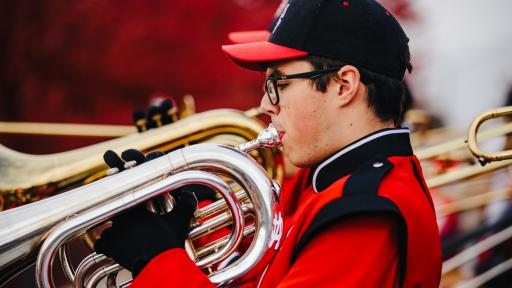 Marching band member performing