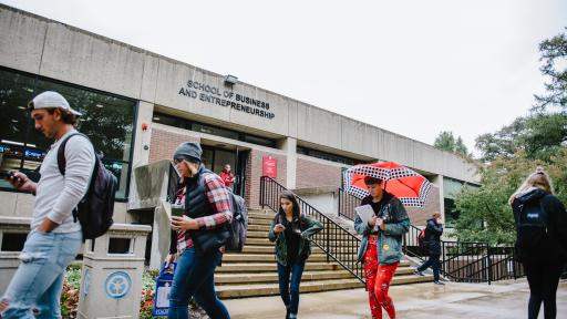 students walking outside of school of business and entrepreneurship
