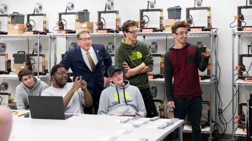 students and president in new engineering lab