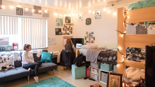 students in residence hall room