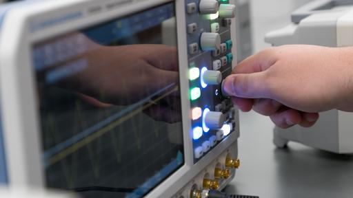 student in molex electronics lab