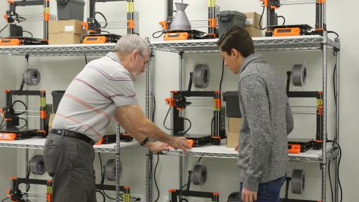 professor and student working with 3D printers