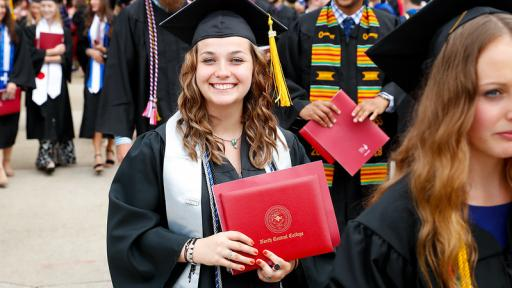 Student at graduation with honors cords