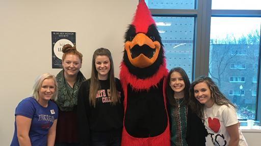 Students in the Blue Key Honor Society meeting with North Central mascot Chippy.