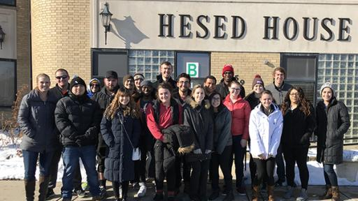 A group of students outside Hesed House homeless shelter.