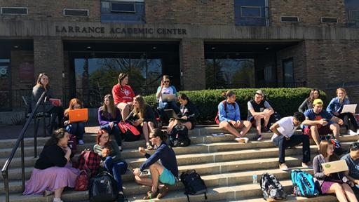 Students sitting on the steps of the Larrance Academic Center.