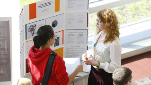 Students discussing a presentation at the annual Rall Symposium.