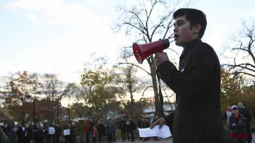 A student holding a megaphone at a protest rally.