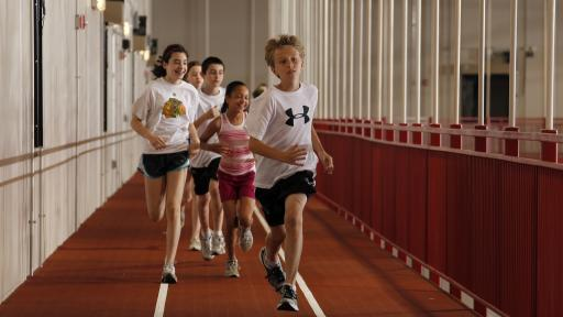 Students running in Res/Rec Arena