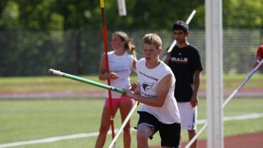 Students practicing pole vault